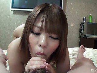 Sweet looking Asian babe Aiko gives a blowjob and gets her slit fucked and creampied
