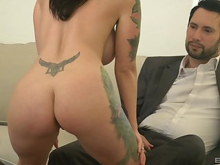 tattooed milf Dolly Darko is ready for hard sex with her friend on the couch