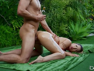 Oiled blonde girl filled up with a fat cock outdoors