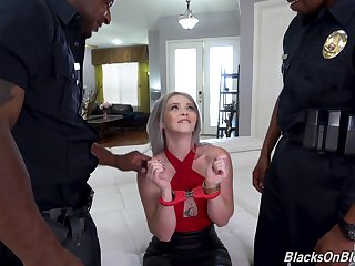 Arrested white chick Kay Carter is double penetrated by two black cops