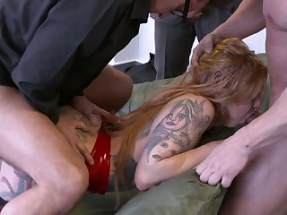 Busty tattooed hooker Mia De Berg is fucked by several brutal studs