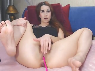 Sexy girl rubs pussy while showing off feet to camera