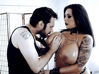 Busty brunette MILF Sheridan Love goes Gothic and enjoys hard doggy fuck