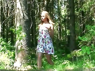 Amateur skinny young chick squats down and pisses in the forest